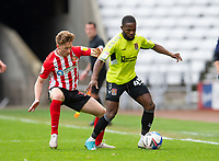 Football - 2020 / 2021 Sky Bet League One - Sunderland vs Northampton Town - Stadium of Light<br /> <br /> Mark Marshall of Northampton Town vies with Denver Hume of Sunderland<br /> <br /> Credit : COLORSPORT/BRUCE WHITE