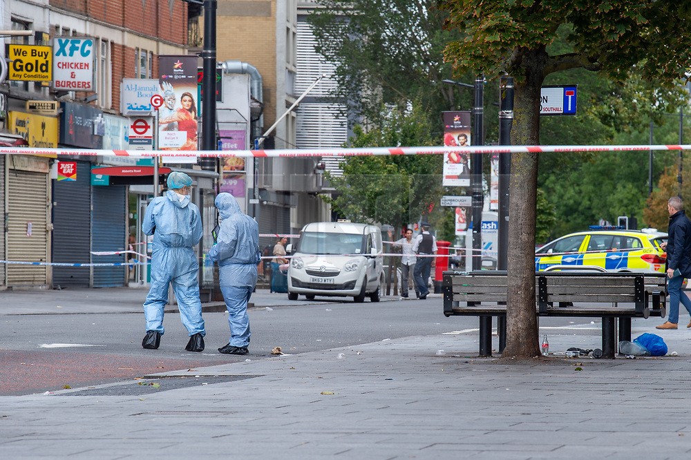© Licensed to London News Pictures. 23/09/2019. London, UK. Forensic investigators at the scene where a man in his 20's was found injured outside a shop in The Broadway, Southall. The man was taken to hospital suffering from a stab injury; he we was pronounced dead at 05:26 BST. Photo credit: Peter Manning/LNP