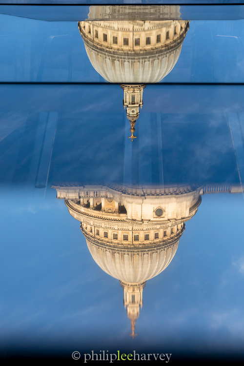 St. Paul's Cathedral reflected in glass upside down, London, England, UK