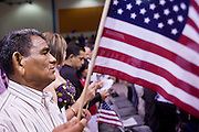 July 4, 2008 -- Phoenix, AZ: A new US citizen waves his American flag after he was naturalized a US citizen at a naturalization ceremony in Phoenix, AZ, Friday. About 300 people from 41 countries were naturalized as US citizens at South Mountain Community College, in Phoenix, AZ, Friday. It was the 20th year the college has hosted the Fiesta of Independence. More than 5,000 people have become naturalized US citizens at the Fiesta of Independence. More than 5,000 people have become naturalized US citizens at the Fiesta of Independence. The largest number of new citizens, 158, came from Mexico. There were also large numbers of new citizens from the Philippines, Bosnia-Herzegovnia and India.  Photo by Jack Kurtz