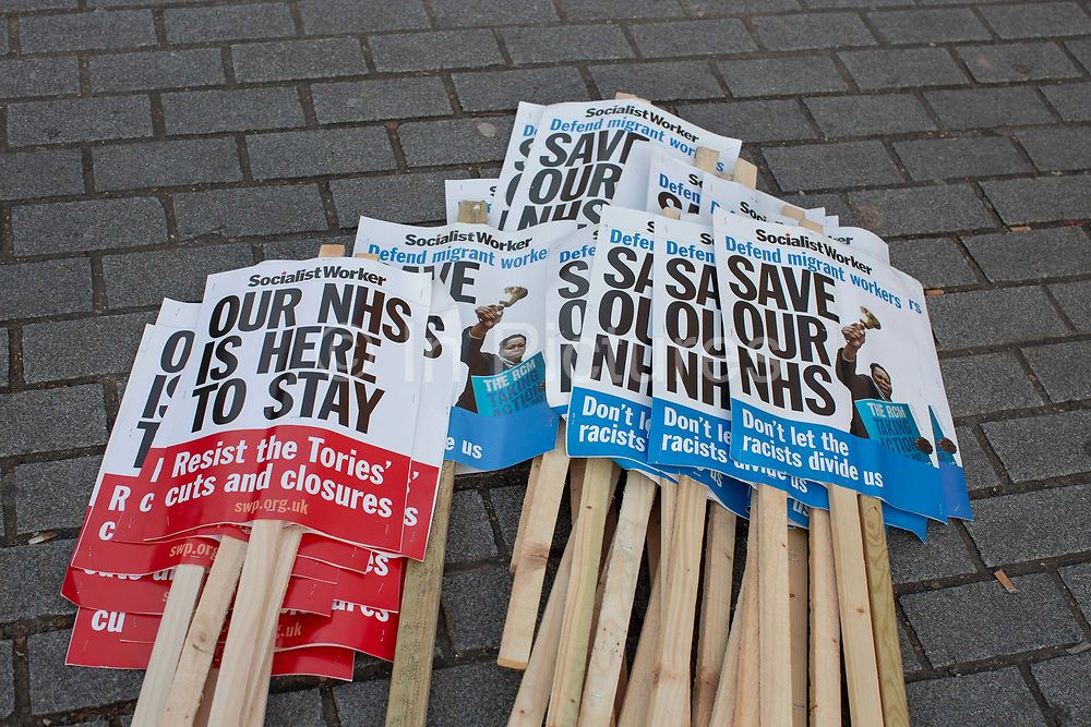 NHS placards during the Stop Trump Coalition and CND protest against U.S. President Donald Trump UK visit to attend the NATO North Atlantic Treaty Organisation summit on the 3rd December 2019 in London in the United Kingdom. Ahead of a British national election on 12th December 2019, Stop Trump Coalition and CND, Campaign for Nuclear Disarmament organised a protest to target a banquet at Buckingham Palace where Trump will dine with the Queen and other NATO leaders. The U.K. is hosting NATO summit to mark the military alliances 70th anniversary.