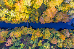 Killiecrankie, Scotland, UK. 12 October 2020.  Looking down on autumn colours on trees surrounding River Garry at Garry Bridge near Killiecrankie. Iain Masterton/Alamy Live News