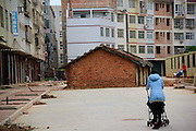 NANNING, CHINA - APRIL 10: (CHINA OUT) <br /> <br /> 40-square-meter house stuck in the middle of the road due to the dispute over the house demolition<br /> <br /> Nail house appears at Yaning street  in Nanning, Guangxi province of China. A 40-square-meter house stuck in the middle of the road due to the dispute over the house demolition compensation between the owner of the house and the Ministry of Housing and Urban-Rural Development in Nanning on April 10.<br /> ©Exclusivepix Media