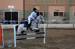 August 5, 2017 - Gaza City, Gaza Strip, Palestinian Territory - A Palestinian boy rides his horse during a jump obstacles championship, in Gaza city on August 4, 2017  (Credit Image: © Mohammed Asad/APA Images via ZUMA Wire)
