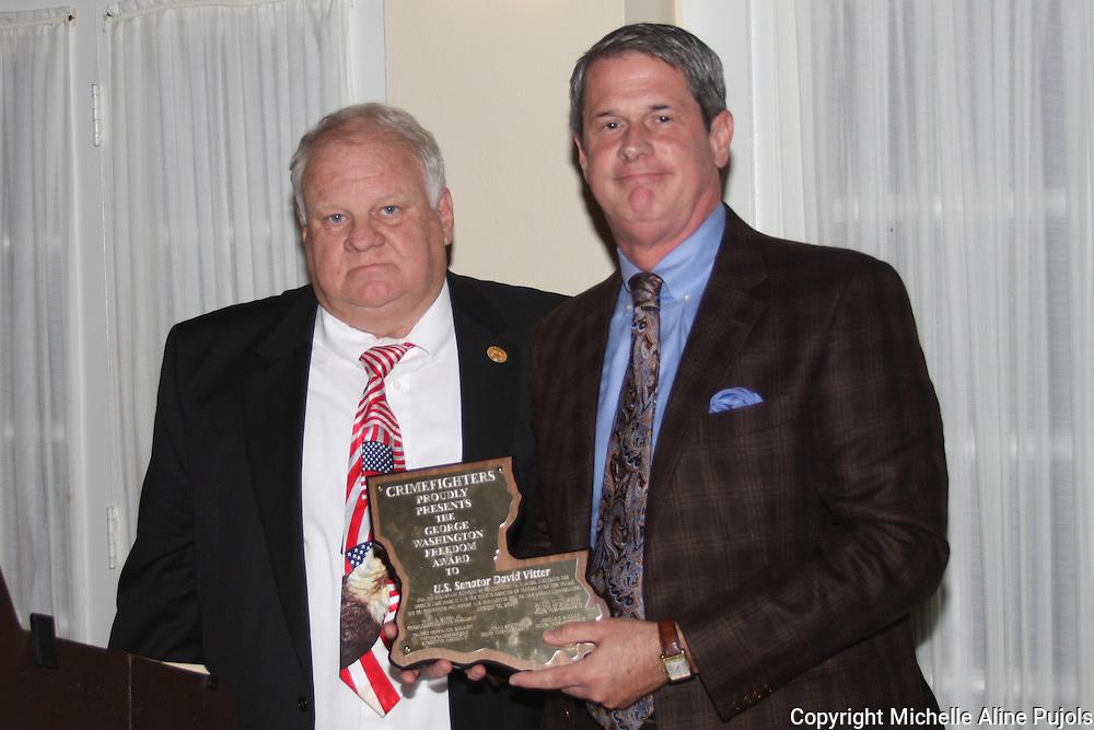 U. S. Senator David Vitter receiving an award at a Crimefighters banquet.