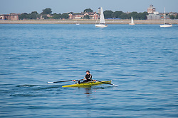 © Licensed to London News Pictures. 11/09/2016. Portsmouth, UK.  A man rowing in the Solent off Southsea promenade in Portsmouth this morning, 11th September 2016.  Photo credit: Rob Arnold/LNP