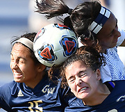 St. Louis University midfielder Anna Lawler (center) leaps for a header between George Washington players Maria Pareja (left) and Rachel Sorkenn. St. Louis University defeated George Washington in the championship game of the Atlantic 10 Conference Women's Soccer Tournament at Robert Hermann Stadium at St. Louis University on Sunday November 10, 2019.<br /> Photon by Tim Vizer