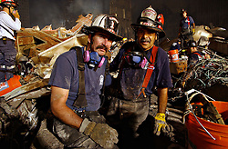 April 29, 2014 - New York, NY, United States of America - San Francisco fire fighters continue to assist in recovery of victims amongst the wreckage of the World Trade Center in the aftermath of a massive terrorist attack which destroyed the twin towers killing 2,606 people September 19, 2001 in New York, NY. (Credit Image: © Andrea Booher/Planet Pix via ZUMA Wire)