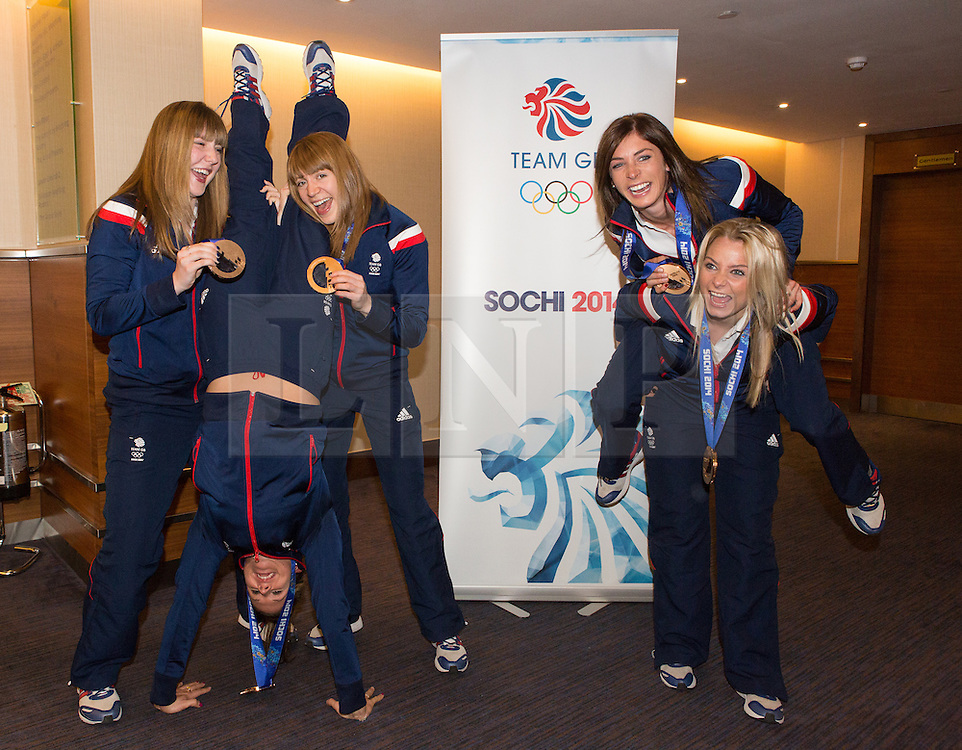 © Licensed to London News Pictures. 25/02/2014. London, UK. Team GB women's curling team share a laugh at the Sofitel Hotel at Heathrow Airport on 24th February 2014. Photo credit : Vickie Flores/LNP