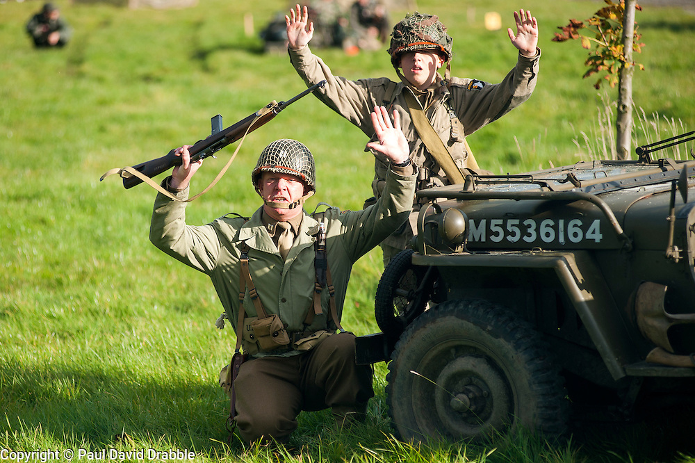 Reenactors portraying US troops surrender in front of their Willys Jeep during a battle reenactment at the Pickering Showground Day 1..13 October 2012.Image © Paul David Drabble