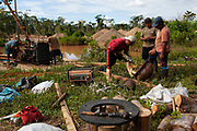 A group of men build a new machine for the extraction of gold in the Peruvian Amazon. Boca Colorado, Peru.