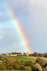 © Licensed to London News Pictures. 22/10/2014. Worcestershire, UK The day after storms and high winds struck the UK a rainbow appears over Rock Church, Worcestershire. Photo credit : Andrew Priest/LNP