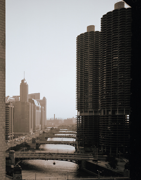 """Marina City stands prominently in Chicago's River North neighborhood and flanks the Chicago River.  Frequently known as the """"Corn on the cob"""" towers, the building houses many condominiums, retail, a hotel, and The House of Blues Nightclub.  Designed by noted Chicago architect Bertrand Goldberg, the two towers were designed in 1959 (by architect Bertrand Goldberg ) and completed in 1964 at a cost of $36 million.  This photo is by Wayne Cable, ©1998, allrights reserved."""