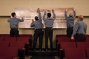 NYPD personnel put up a banner before Mayor Bill de Blasio administers the Oath of Office to NYPD Recruits at Queens College, 65-30 Kissena Blvd, Flushing, NY on Thursday, Jan. 9, 2014.<br /> <br /> CREDIT: Andrew Hinderaker for The Wall Street Journal<br /> SLUG: NYSTANDALONE