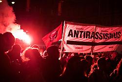"""06.03.2020, Innenstadt, Wien, AUT, Demonstration Reporter ohne Grenzen (ROG), Bewegung """"Rosa Antifa Wien"""", Asyl in Not """"Transnationale Solidarität gegen Rassismus und Krieg"""", im Bild ein Demonstrant der ANTIFA mit einem bengalischen Feuer// demonstration Reporters Without Borders, """"Rosa Antifa Wien"""" movement, asylum in need """"Transnational Solidarity Against Racism and War"""" at the inner city in Vienna, Austria on 2020/03/06. EXPA Pictures © 2020, PhotoCredit: EXPA/ Florian Schroetter"""