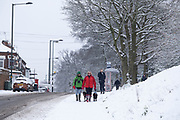 Local people enjoy playing in the snow near Kings Heath Park in Kings Heath on 24th January 2021 in Birmingham, United Kingdom. Deep snow arrived in the Midlands giving some light relief and fun during the current lockdown for people who simply enjoyed the weather.