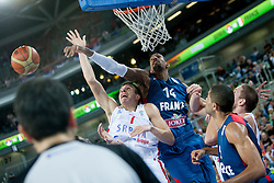 Bogdan Bogdanovic #7 of Serbia vs Alexis Ajinca #14 of France during basketball match between National teams of France and Serbia in 2nd Round at Day 12 of Eurobasket 2013 on September 14, 2013 in SRC Stozice, Ljubljana, Slovenia. (Photo By Urban Urbanc / Sportida)