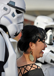© Licensed to London News Pictures. 30/10/2011. London, UK. A woman visitor has her picture taken with people dressed as Storm troopers. The London Comic Con today, 30th October 2011 as fans of comics, computer games and Sci-Fi movies,  dress up as some of their favourite characters. The London MCM Expo takes place on 28-30th October 2011 at the excel centre in London.  Photo: Stephen Simpson/LNP
