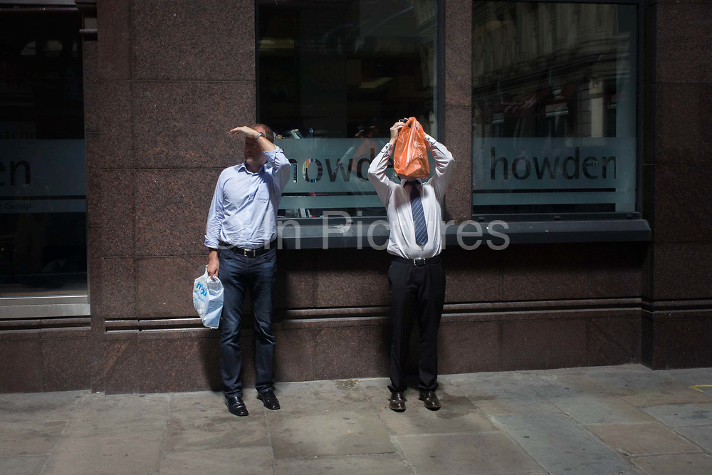 Londoners experience the unexpected intensity of localised solar rays, reflected off the concave plate glass windows of one of the capital's newest skyscrapers known as the Walkie Talkie. The hotspot has surprised developers and passers-by below and which has already melted a parked car and left soft street fittings smouldering in Eastcheap Street, City of London, the capital's financial district. Thermometers placed in the street reached 144F (62 celcius) and city workers poured out of their offices at lunchtime to winess the strange phenomena of intense light and heat.