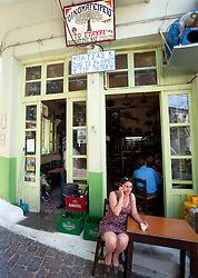 Woman in small cafe in town of Agiassos on Lesvos Island in Greece