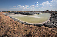 Frack pond, part of  hydraulic fracturing industry in the  Permian Basin in West Texas. Despite an ongoing drought there is no limit who much water fracking companies can use. In the Permian Basin, fracking compaines are using brine water.