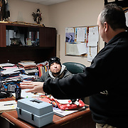 Water plant operator, Aaron Henry (right), with Fabian Blackhawk, a member of the Chief's council, at the Band Office at the Ochiichagwe'Babigo'Ining Ojibway Nation reserve (also known as the Dalles First Nation) in Northern Ontario, Canada on 15 December 2016. The water treatment plant is participating in a pilot program which will see water quality monitored in real time via an Internet link to a central Water Hub at the Bimose Tribal Council in the town of Kenora, about 30 minutes drive away.