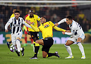 Watford's Etienne Capoue tussles with WBA's Hal Robson-Kanu and Jake Livermore during the Premier League match at Vicarage Road Stadium, London. Picture date: April 4th, 2017. Pic credit should read: David Klein/Sportimage