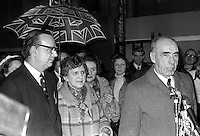 Johnny McQuade, Ulster Unionist runner-up, addresses supporters after the West Belfast count in the City Hall following the February 1974 UK General Election.  The elected MP, Gerry Fitt, SDLP, shelters under a Union Jack umbrella. 197403010136JMQ<br /> <br /> Copyright Image from Victor Patterson, Belfast, UK<br /> <br /> t: +44 28 9066 1296 (from Rep of Ireland 048 9066 1296)<br /> m: +44 7802 353836<br /> e: victorpattersonbelfast@gmail.com<br /> <br /> www.images4media.com<br /> <br /> Please see my full Terms and Conditions of Use at https://www.images4media.com/p/terms-conditions - it is IMPORTANT that you familiarise yourself with them.<br /> <br /> Images used online incur an additional cost. This cost should be agreed in writing in advance. Online images must be visibly watermarked i.e. © Victor Patterson or that of the named photographer within the body of the image. The original metadata must not be deleted from images used online.<br /> <br /> This image is only available for the use of the download recipient i.e. television station, newspaper, magazine, book publisher, etc, and must not be passed on to a third party. It is also downloaded on condition that each and every usage is notified within 7 days to victorpattersonbelfast@gmail.com.<br /> <br /> The right of Victor Patterson (or the named photographer) to be identified as the author is asserted in accordance with The Copyright Designs And Patents Act (1988). All moral rights are asserted.
