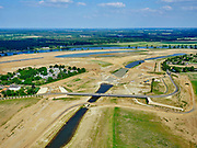 Nederland, Limburg, Gemeente Horst aan de Maas.; 27-05-2020; Ooijen, nieuwe brug over de (uitgegraven) Oude Maasarm tussen Ooijen en Wanssum. Links het recreatiepark Kasteel Ooijen. Bij hoogwater kan de de oude rivier weer mee gaan stromen. Onderdeel van <br /> Gebiedsontwikkeling  Ooijen en Wanssum, waaronder aanleg van een  hoogwatergeul, weerdverlaging en natuurontwikkeling.<br /> Ooijen, new bridge over the (excavated)  old branch of the Meuse. On the left the recreation park Kasteel Ooijen. At high tide, the old river can flow again.<br /> <br /> luchtfoto (toeslag op standard tarieven);<br /> aerial photo (additional fee required)<br /> copyright © 2020 foto/photo Siebe Swart