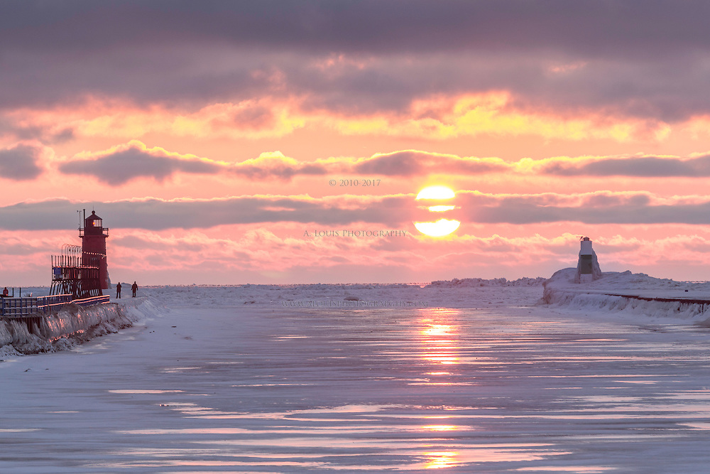 The setting sun reflects down the the frozen Black River in South Haven