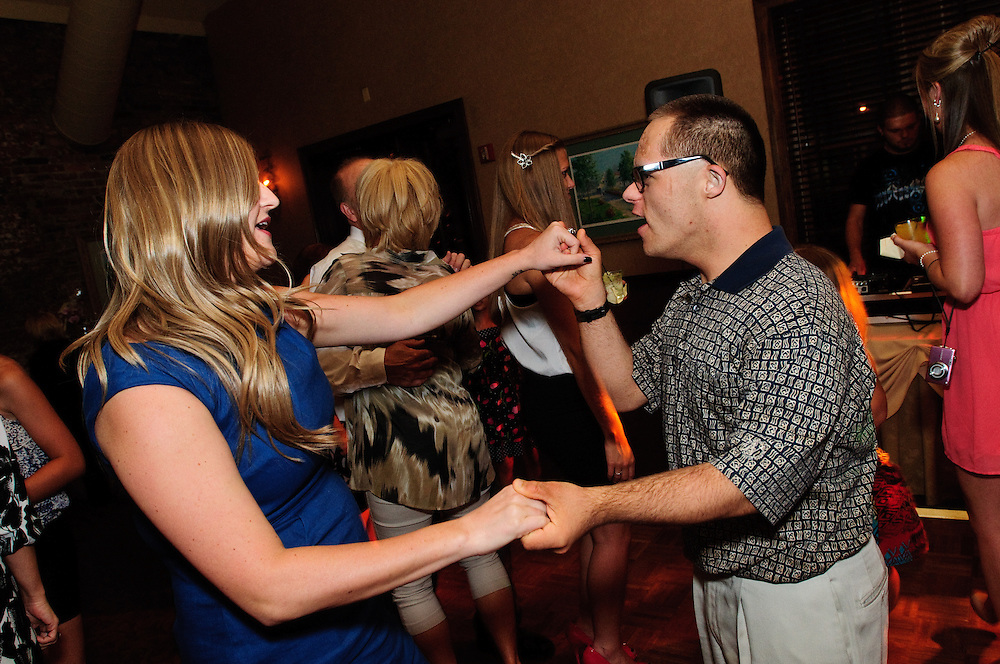 Wayne and Rita Polek celebrate their 25th wedding anniversary with family and friends at the Harrington Inn & Spa in St. Charles, IL. July 13, 2012. © 2012 Brian J. Morowczynski ViaPhotos