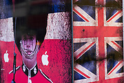 Union Jack flags and a Grenadier Guard outside a shop on Oxford Street on 28th January 2021 in London, United Kingdom.