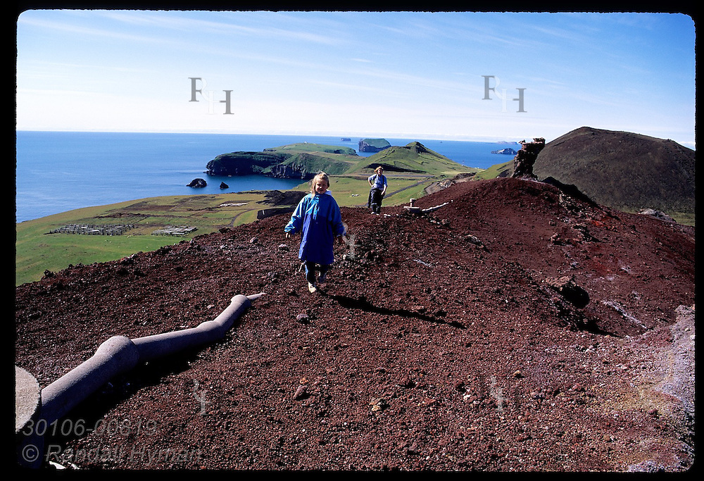 Girl & mom arrive @ summit of Eldfell volcano, formed in the 1973 eruption on Heimaey; Westman Is. Iceland