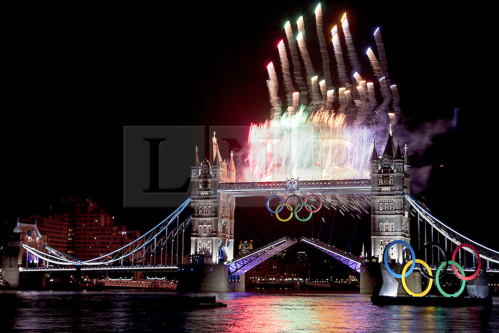 © Licensed to London News Pictures. 27/07/2012. London, UK. Fireworks at Tower Bridge in London for the Opening Ceremony of the Olympic Games. Photo credit : Vickie Flores/LNP.