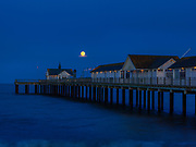 Full Moonrise over the Southwold Pier on the English Coast. Licensing and Open Edition Prints.