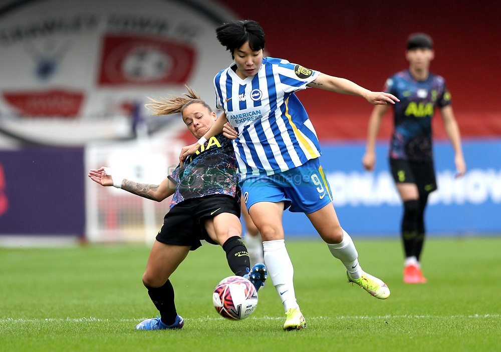 Brighton and Hove Albion's Lee Geum-min (right) and Tottenham Hotspur's Ria Percival battle for the ball during the FA Women's Super League match at the People's Pension Stadium, Crawley. Picture date: Sunday October 10, 2021.