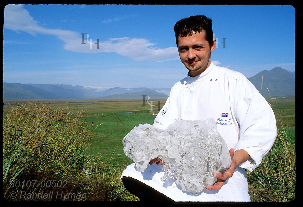 Johann Johannesson, chef at Hotel Vatnajokull, poses with chunk of glacial ice used in alcoholic drinks; Hofn, southeast Iceland.