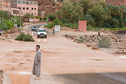 Man observing river crossing during flood at Ait Snan on road to Todra Gorge, Morocco