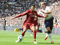 Football - 2018 / 2019 Premier League - Tottenham Hotspur vs. Liverpool<br /> <br /> Joe Gomez of Liverpool fends off Harry Kane, at Wembley Stadium.<br /> <br /> COLORSPORT/ANDREW COWIE