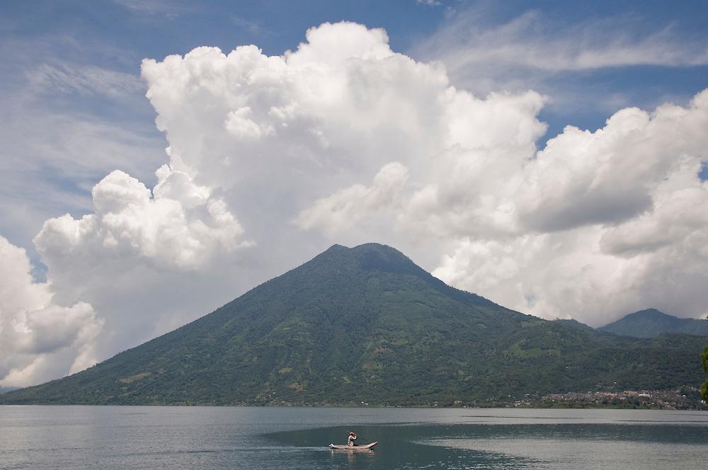 A fishman in front of San Pedro Volcano, Lago de Atitlan, Guatemala. July 2009.  (Photo/William Byrne Drumm)