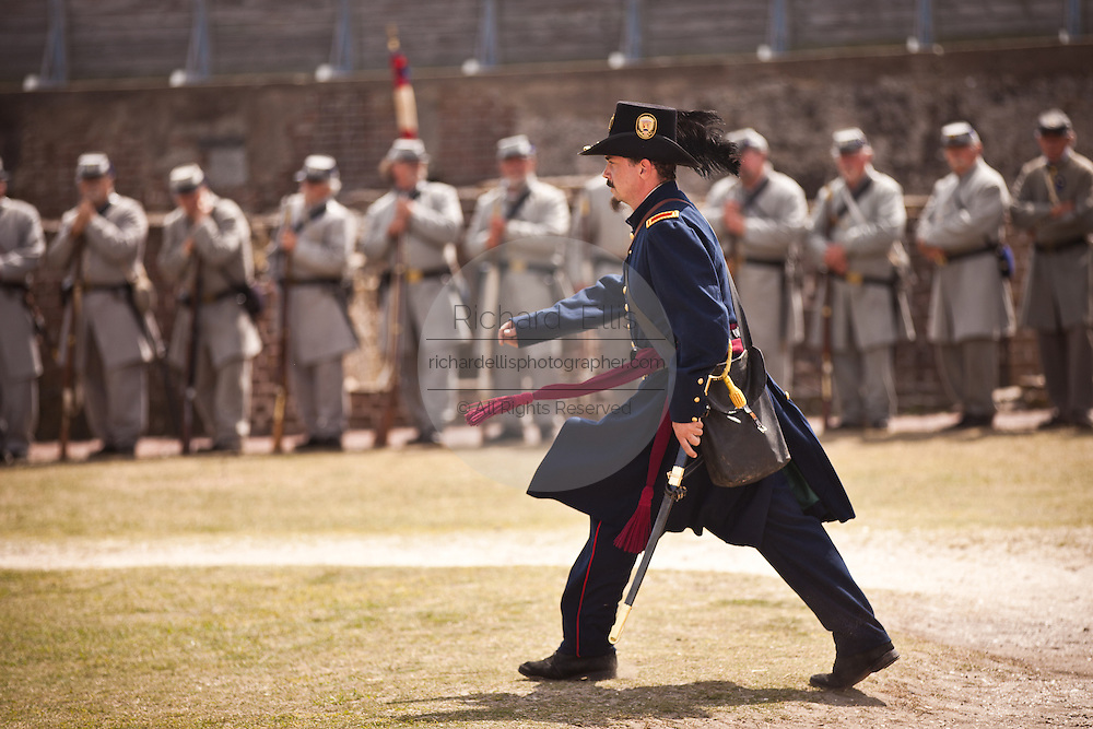 A Union re-enactor marches past Confederate troops at Fort Sumter on the 150th anniversary of the surrender of the fort in the US Civil War on April 14, 2011 in Charleston, South Carolina.  The surrender of the fort marks the end of a week long commemoration of the start of the Civil War.