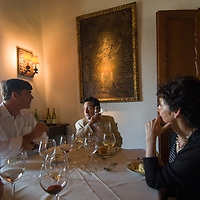 Travelers relax and taste wines at the Santa Rita winery near Santiago, Chile.