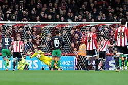 Richard O'Donnell of Bristol City makes a penalty save from Scott Hogan of Brentford - Mandatory by-line: Dougie Allward/JMP - 16/04/2016 - FOOTBALL - Griffin Park - Brentford, England - Brentford v Bristol City - Sky Bet Championship