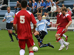 FODBOLD: Dennis Borup (Helsingør) presses af Rune Dalgaard (Allerød) under kampen i Danmarksserien, pulje 1, mellem Elite 3000 Helsingør og Allerød FK den 7. september 2008 på Helsingør Stadion. Foto: Claus Birch