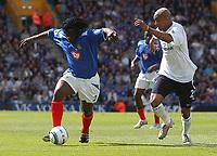 Photo: Alan Crowhurst. Portsmouth v Bolton, Barclays Premiership, 07/05/2005.  Portsmouth's Linvoy Primus takes on El-Hadji Diouf.