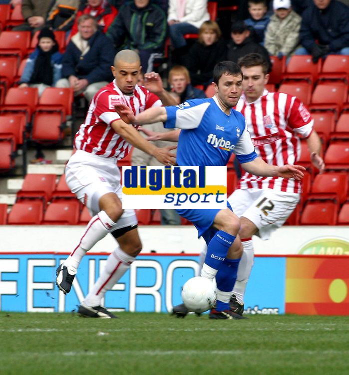 Photo: Dave Linney.<br />Stoke City v Birmingham City. The FA Cup. 19/02/2006.<br />Bham's Damien Johnson(C) tries to find a way through the Stoke defence