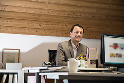 Portrait of a mature businessman working on computer in an office, Bavaria, Germany