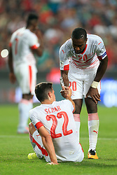 10th September 2017 - 2018 FIFA World Cup Qualifying (Group B) - Portugal v Switzerland - Johan Djourou of Switzerland tends to dejected teammate Fabian Schar after the match - Photo: Simon Stacpoole / Offside.