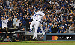 October 31, 2017 - Los Angeles, CA, USA - Los Angeles Dodgers' Joc Pederson (31) high fives third base coach Chris Woodward after hitting a solo home run in the 7th inning of game six of a World Series baseball game at Dodger Stadium on Tuesday, Oct. 31, 2017 in Los Angeles. (Credit Image: © Keith Birmingham/Los Angeles Daily News via ZUMA Wire)