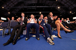 © Licensed to London News Pictures. 02/10/2011. Manchester, UK. A live link to Lord Coe (on screen on the right) and Hugh Robertson MP (on screen on the left) discussing the Olympic and Paralympic games, watched by an audience which includes Conference delegates and athletes due to participate in the upcoming London Games. Photo credit : Joel Goodman/LNP